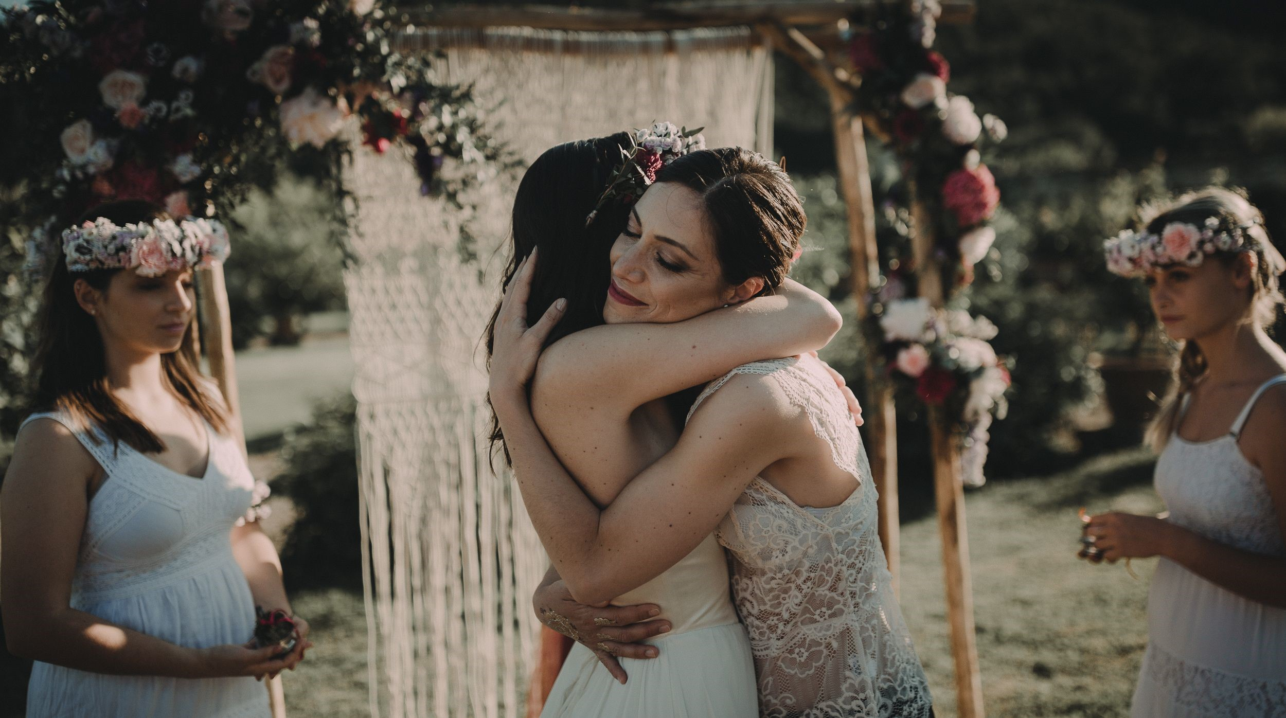 Federica and Claudia tender embrace during their marriage